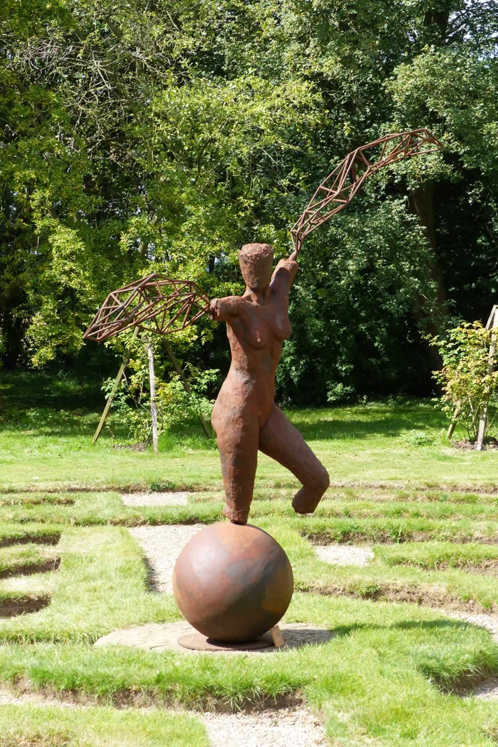 Arc I at Doddington Hall (abstract figurative sculpture) by sculptor Ian Campbell-Briggs