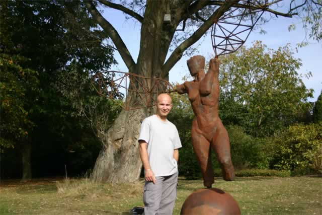 Arc I at Leicester Botanic Gardens with sculptor, Ian Campbell-Briggs (abstract figurative sculpture)
